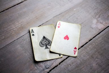 a two aces on a grey wooden background